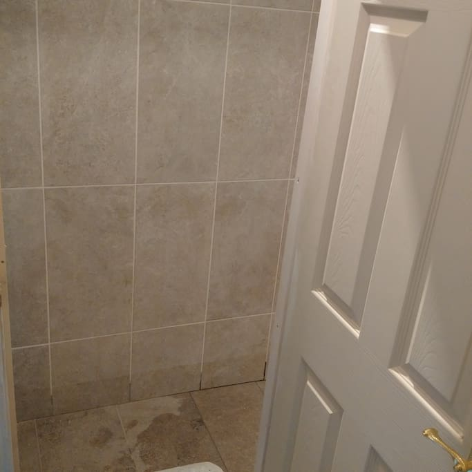 Large, newly built wetroom with non-slip floor tiling, a power shower, stylish spot lighting and GFCH (hot water is instant and always available). Bathroom is stocked with shampoo and high quality moisturising body wash.
