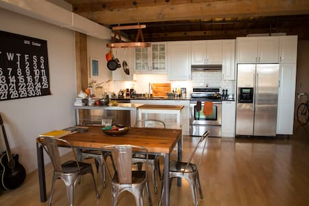 Modern open style loft with exposed brick, 100 year old fir beams. Wood floors, heated tile bathroom floors, amazing kitchen.   Downtown, Just below Pike place market on the waterfront in the most urban and beautiful part of downtown Seattle.