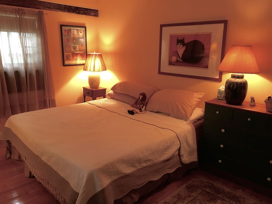 King size bed in large air-conditioned room.