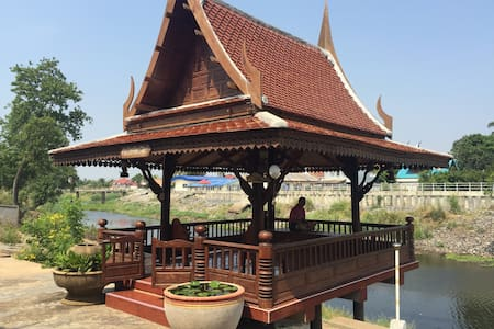 Traditional Thai house near river - Talo