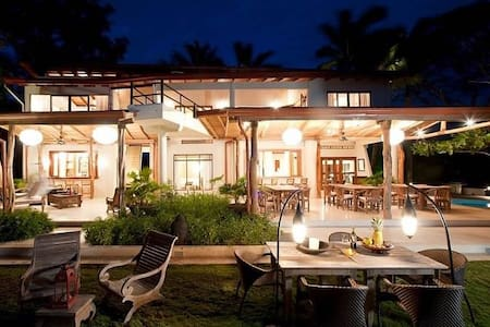 Perched 500 feet above the waves of the Pacific Ocean and playa Guiones is Tierra Magnifica. This estate is comprised of 9 luxury guest suites and each room has a private bathroom and balcony with spectacular ocean and lush jungle views. The rooms are decorated with hand-crafted furniture from Bali and luxurious linens. Bedding consists of a king size bed and twin bed in bedroom one, queen size bed in bedroom two, two queen beds in bedroom three, king size bed in bedroom four and bedroom five, two king beds in both bedroom six and seven and king size bed in bedroom eight. Property amenities includes a fully-equipped professional kitchen, ocean view covered dining, open-air bar and lounge, large pool and sun deck, free Wi-Fi internet access, satellite TV and guest library, nature trail,private waterfall and swimming hole, daily housekeeping, full kitchen staff, concierge services and 24-hour security. This home can accommodate 25 guests.