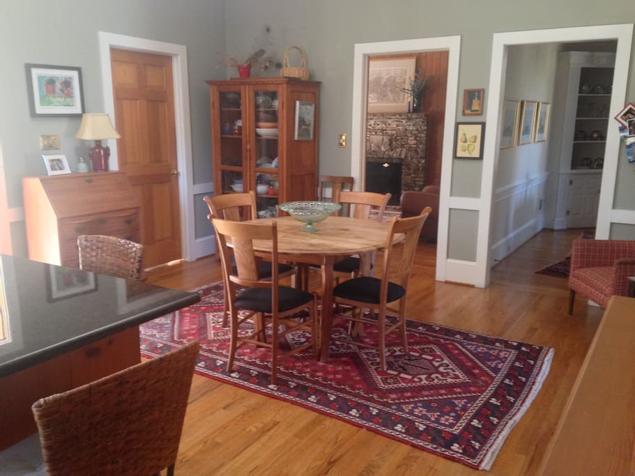 Large kitchen with dining area and island with 3 stools