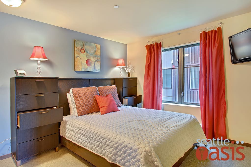 The spacious master bedroom offers a plush queen-sized bed.