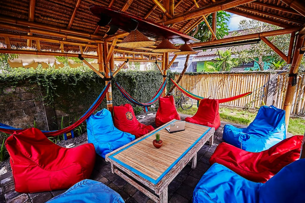 large comunnity space where our guests relax in hammocks, work or eating. Highly addictive!