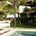 beautiful rustic teak house big lawn and  garden  big beautiful pool ..