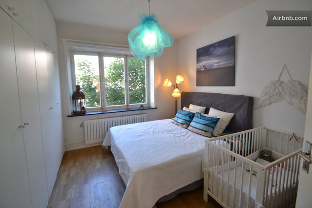Stockholm vacation rentals short term rentals airbnb Master bedroom with a crib